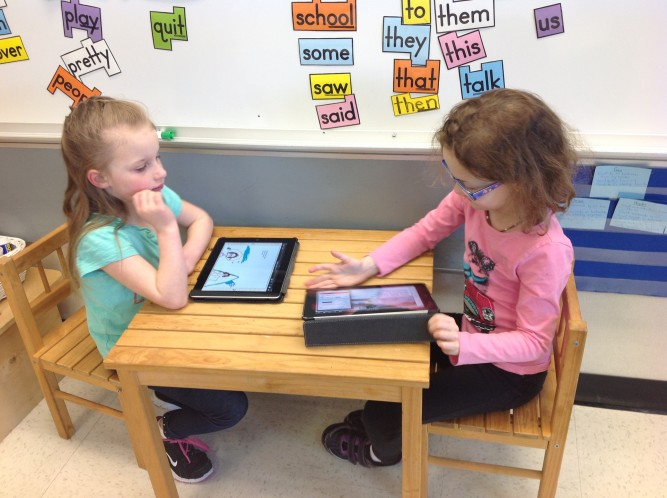 Students using iPads to write
