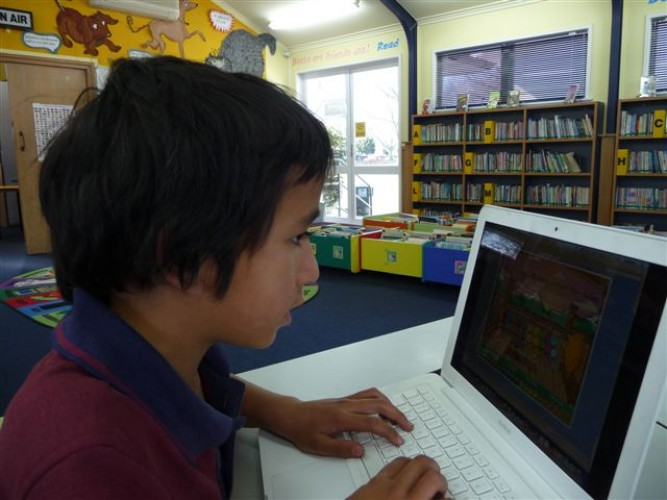 A student touch typing on a laptop