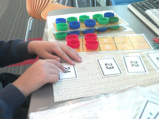 A student using concrete materials to support numeracy
