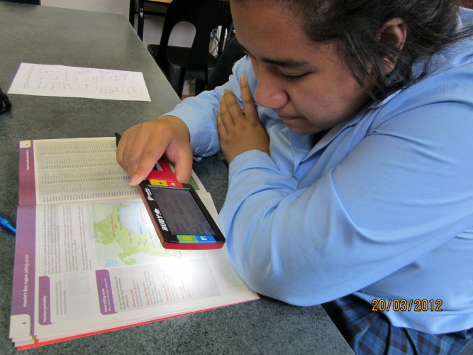 A student reading from mobile phone