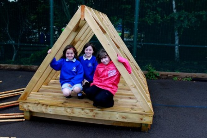 Students in a playhouse