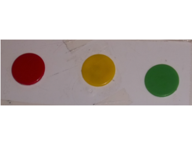 Red, orange, and green counters making a traffic light system