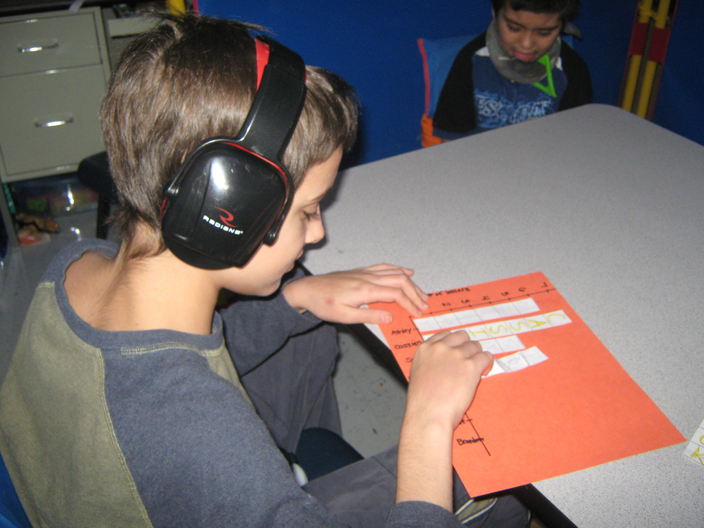 Student using headphones to remove noise distractions